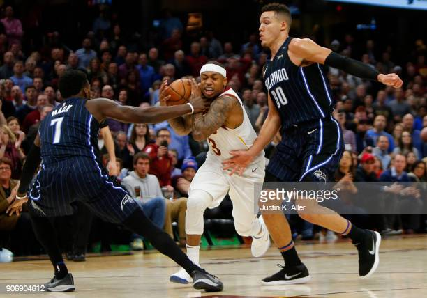Isaiah Thomas of the Cleveland Cavaliers is fouled late in the game by Shelvin Mack of the Orlando Magic at Quicken Loans Arena on January 18 2018 in...