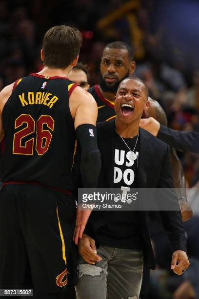 Isaiah Thomas of the Cleveland Cavaliers reacts with Kyle Korver on the bench during the second half while playing the Sacramento Kingsat Quicken...