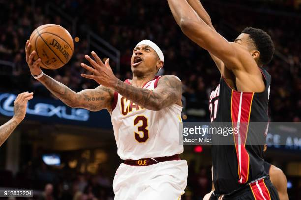 Isaiah Thomas of the Cleveland Cavaliers shoots over Hassan Whiteside of the Miami Heat during the second half at Quicken Loans Arena on January 31...