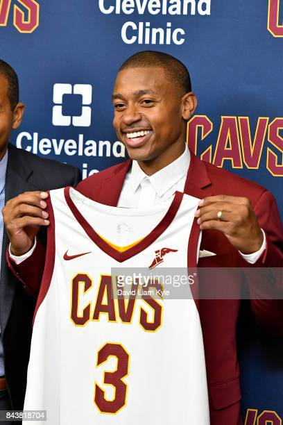 Isaiah Thomas of the Cleveland Cavaliers shows of his new jersey as he is introduced to the media at The Cleveland Clinic Courts on September 7 2016...