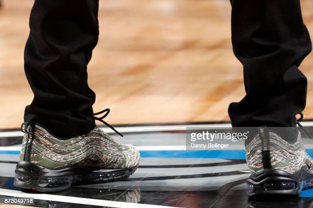 Isaiah Thomas of the Cleveland Cavaliers sneakers courtside during the game versus the Dallas Mavericks on Novemeber 11 2017 at the American Airlines...