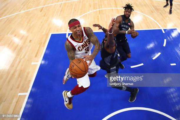 Isaiah Thomas of the Cleveland Cavaliers tries to get a shot off past Anthony Tolliver of the Detroit Pistons during the second half at Little...