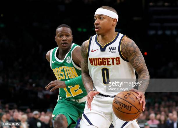 Isaiah Thomas of the Denver Nuggets drives against Terry Rozier of the Boston Celtics during the first quarter at TD Garden on March 18 2019 in...