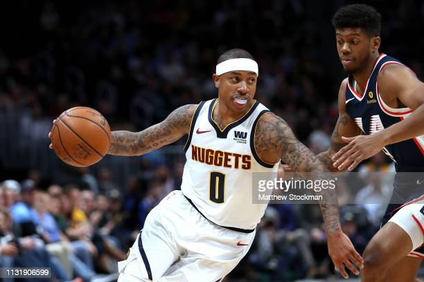 Isaiah Thomas of the Denver Nuggets drives against Tyrone Wallace of the Los Angeles Clippers in the fourth quarter at the Pepsi Center on February...