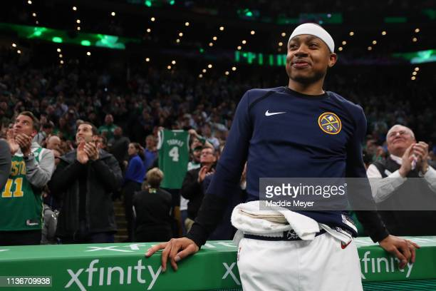 Isaiah Thomas of the Denver Nuggets watches a tribute video played in his honor during the first quarter of the game against the Boston Celtics at TD...