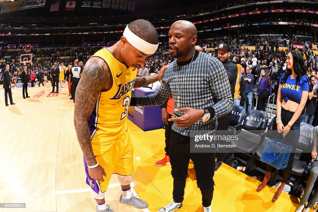 Isaiah Thomas #3 of the Los Angeles Lakers and Floyd Mayweather talk after the game against the Denver Nuggets on March 13, 2018 at STAPLES Center in Los Angeles, California.