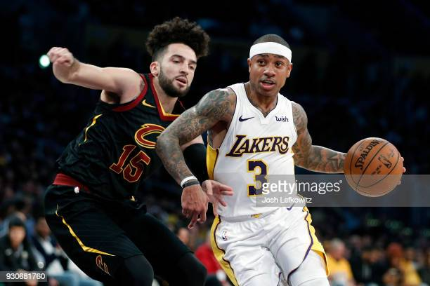 Isaiah Thomas of the Los Angeles Lakers drives to the basket against London Perrantes of the Cleveland Cavaliers during the fourth quarter of the...