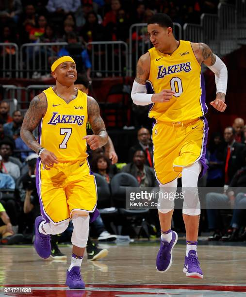 Isaiah Thomas of the Los Angeles Lakers reacts with Kyle Kuzma during the game against the Atlanta Hawks at Philips Arena on February 26 2018 in...