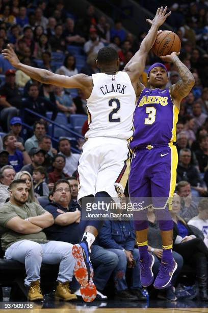 Isaiah Thomas of the Los Angeles Lakers shoots over Ian Clark of the New Orleans Pelicans during the first half at the Smoothie King Center on March...