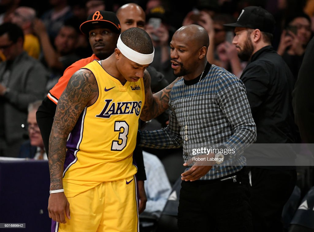 Isaiah Thomas #3 of the Los Angeles Lakers talks to retired boxer Floyd Mayweather after the game against the Denver Nuggets on March 13, 2018 at STAPLES Center in Los Angeles, California.