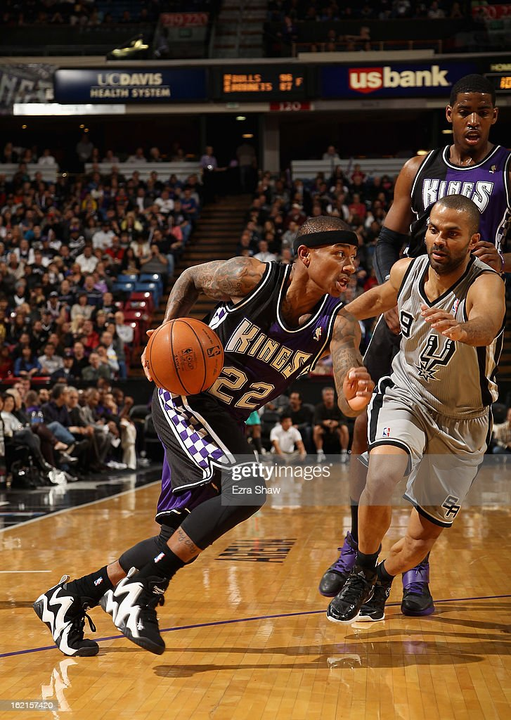Isaiah Thomas #22 of the Sacramento Kings dribbles past Tony Parker #9 of the San Antonio Spurs at Sleep Train Arena on February 19, 2013 in Sacramento, California.