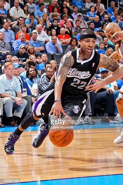 Isaiah Thomas of the Sacramento Kings drives against Derek Fisher of the Oklahoma City Thunder on April 24 2012 at the Chesapeake Energy Arena in...