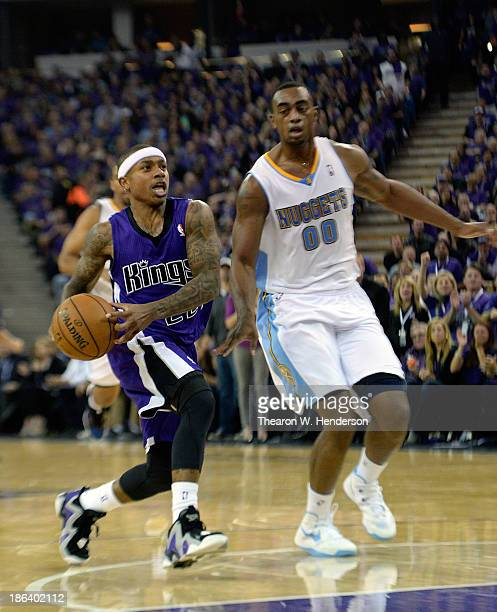Isaiah Thomas of the Sacramento Kings drives past Darrell Arthur of the Denver Nuggets during the third quarter at Sleep Train Arena on October 30...