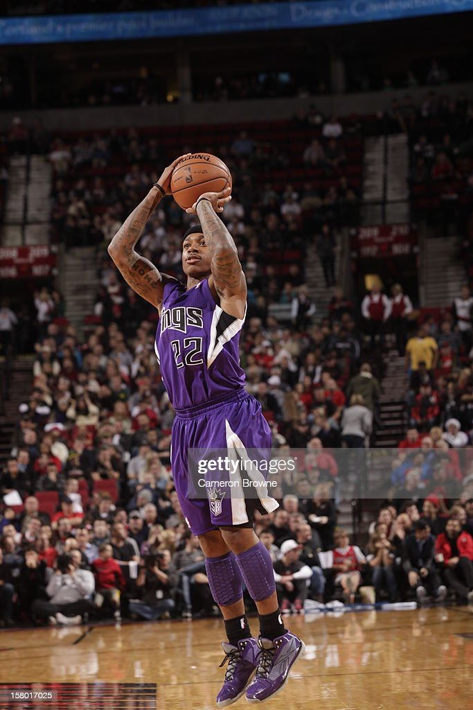 Isaiah Thomas #22 of the Sacramento Kings goes for a jump shot during the game between the Sacramento Kings and the Portland Trail Blazers on December 8, 2012 at the Rose Garden Arena in Portland, Oregon.