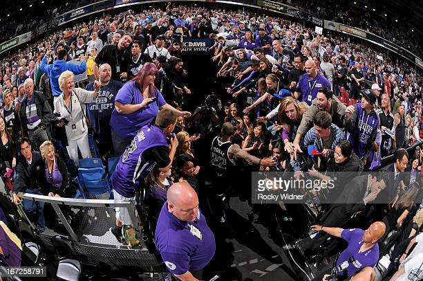 Isaiah Thomas of the Sacramento Kings greets fans while heading into the tunnel in a game against the Los Angeles Clippers on April 17 2013 at Sleep...
