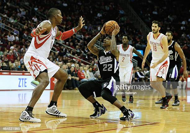 Isaiah Thomas of the Sacramento Kings looks to pass against Dwight Howard of the Houston Rockets during the game at the Toyota Center on January 22...
