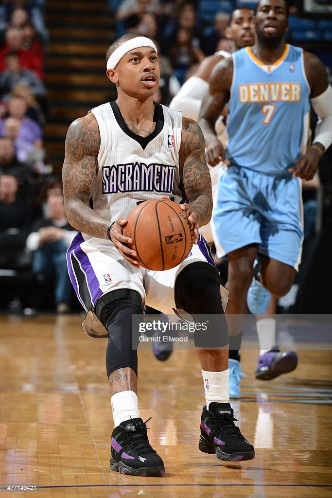 Isaiah Thomas #22 of the Sacramento Kings sets up for the shot against the Denver Nuggets at Sleep Train Arena on January 26, 2014 in Sacramento, California.