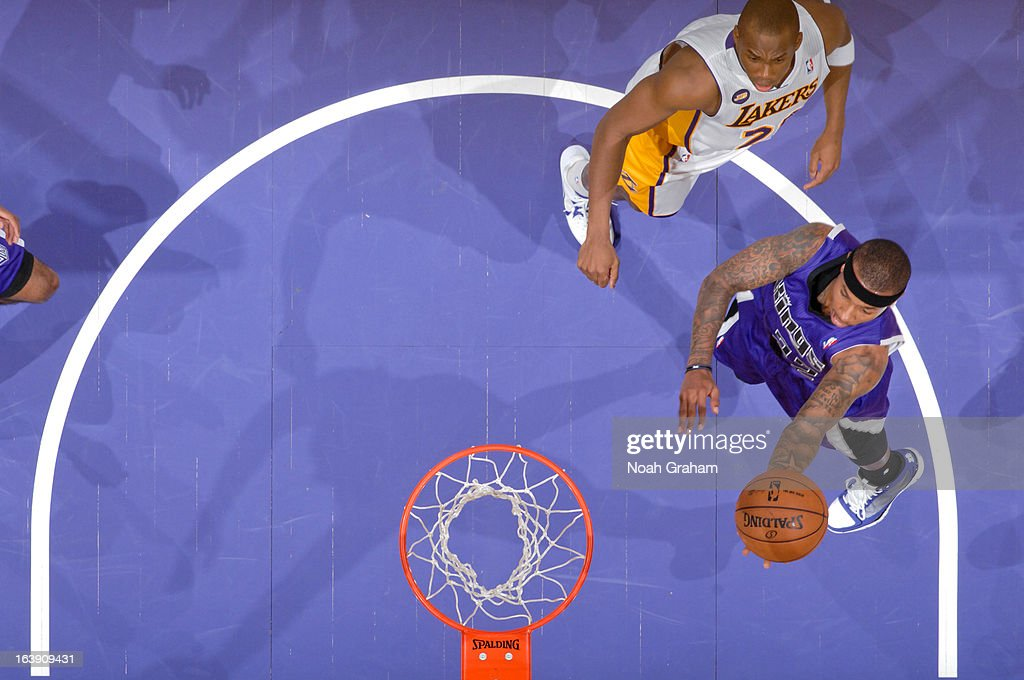 Isaiah Thomas #22 of the Sacramento Kings shoots a layup against Jodie Meeks #20 of the Los Angeles Lakers at Staples Center on March 17, 2013 in Los Angeles, California.
