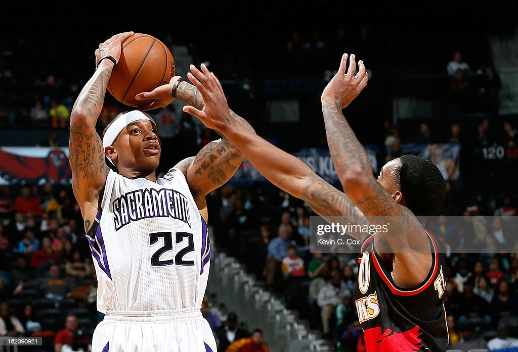 Isaiah Thomas #22 of the Sacramento Kings shoots a three-point basket over Jeff Teague #0 of the Atlanta Hawks at Philips Arena on February 22, 2013 in Atlanta, Georgia.