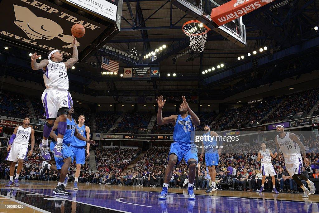 Isaiah Thomas #22 of the Sacramento Kings shoots against Elton Brand #42 of the Dallas Mavericks on January 10, 2013 at Sleep Train Arena in Sacramento, California.