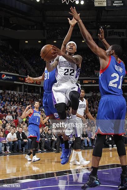 Isaiah Thomas of the Sacramento Kings takes the ball to the basket against Thaddeus Young of the Philadelphia 76ers at Sleep Train Arena on January 2...