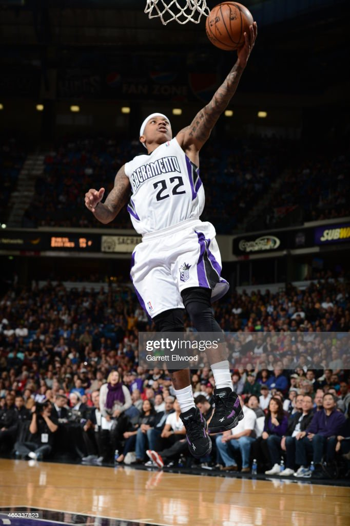 Isaiah Thomas #22 of the Sacramento Kings takes the ball to the basket against the Denver Nuggets at Sleep Train Arena on January 26, 2014 in Sacramento, California.