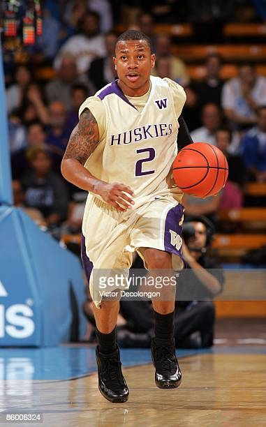 Isaiah Thomas of the Washington Huskies dribbles the ball upcourt in the first half during their NCAA basketball game against the UCLA Bruins at...