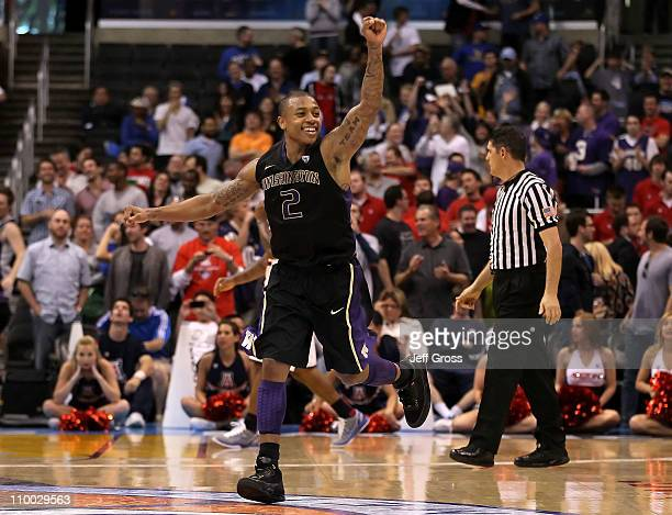 Isaiah Thomas of the Washington Huskies reacts as the Arizona Wildcats miss a buzzer shot and the game goes into overtime in the championship game of...