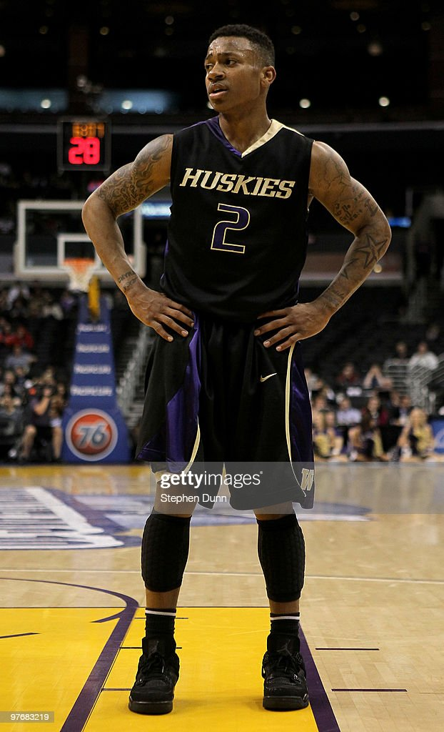 05c057d0a825 Isaiah Thomas of the Washington Huskies stands on the against the ...