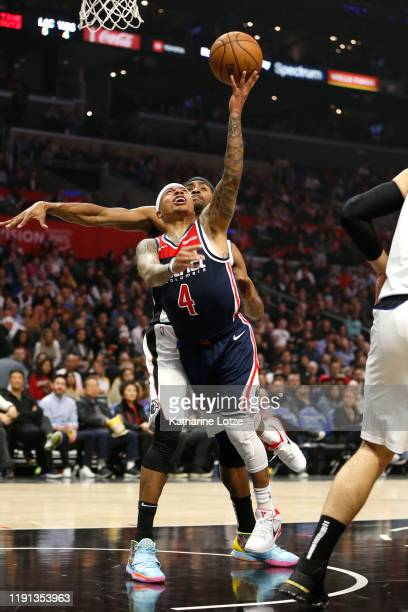 Isaiah Thomas of the Washington Wizards goes up for a shot as Maurice Harkless of the Los Angeles Clippers defends during the first half at Staples...