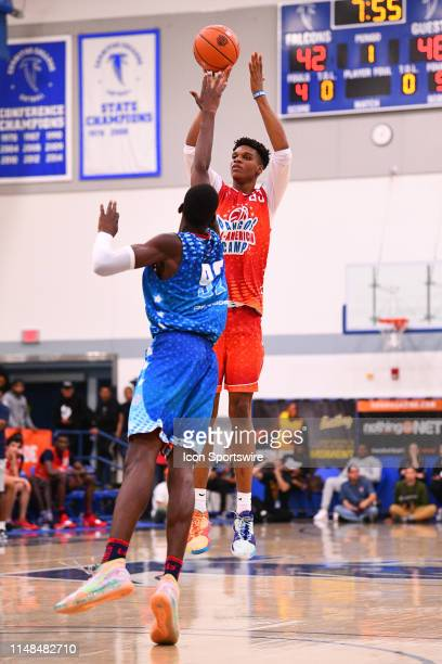 Isaiah Todd from Trinity Academy shoots over a defender during the Pangos AllAmerican Camp on June 2 2019 at Cerritos College in Norwalk CA