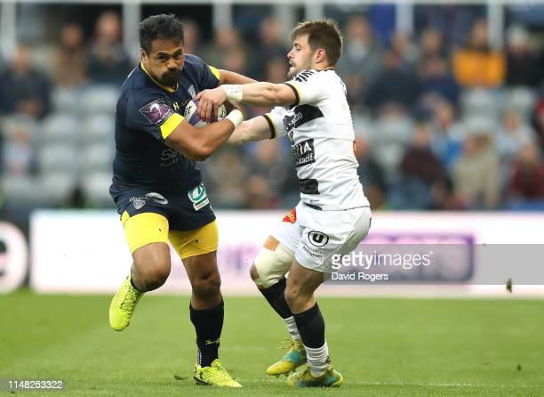 Isaiah Toeava of ASM Clermont is tackled by Arthur Retiere of La Rochelle during the Challenge Cup Final match between La Rochelle and ASM Clermont...