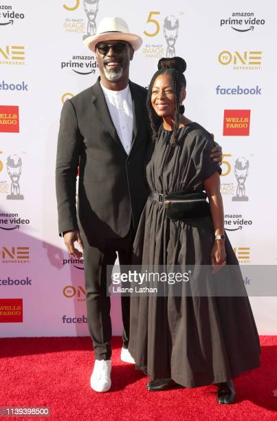 Isaiah Washington and Jenisa Garland attend the 50th NAACP Image Awards at Dolby Theatre on March 30 2019 in Hollywood California