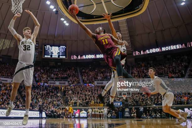 Isaiah Washington of the Minnesota Golden Gophers shoots the ball as Nojel Eastern of the Purdue Boilermakers defends from behind at Mackey Arena on...