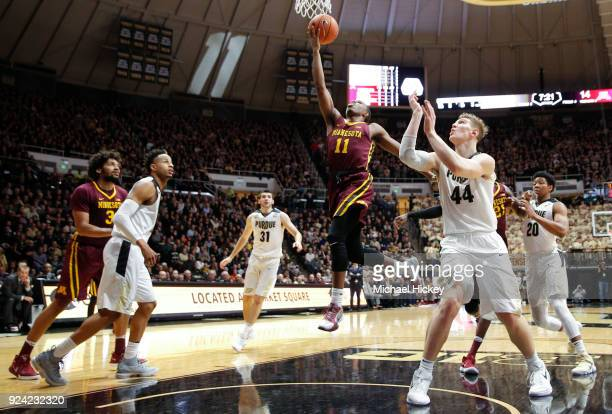 Isaiah Washington of the Minnesota Golden Gophers shoots the ball against Isaac Haas of the Purdue Boilermakers at Mackey Arena on February 25 2018...