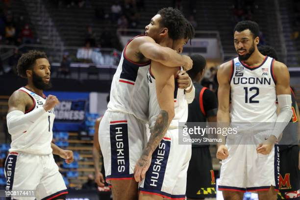 Isaiah Whaley of the Connecticut Huskies and James Bouknight hug during the second half against the Maryland Terrapins in the first round game of the...