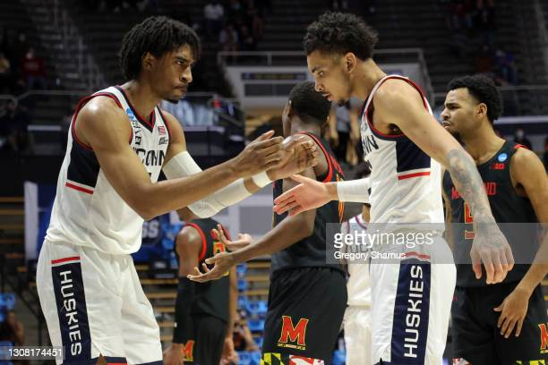 Isaiah Whaley of the Connecticut Huskies and James Bouknight react during the second half against the Maryland Terrapins in the first round game of...