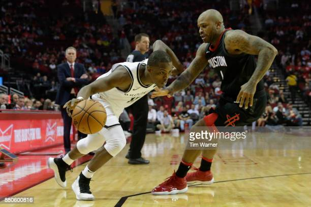 Isaiah Whitehead of the Brooklyn Nets ddrives to the basket defended by PJ Tucker of the Houston Rockets in the first half at Toyota Center on...