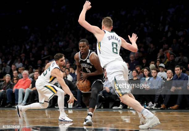 Isaiah Whitehead of the Brooklyn Nets drives to the basket against Raul Neto and Jonas Jerebko of the Utah Jazz in the second half during their game...