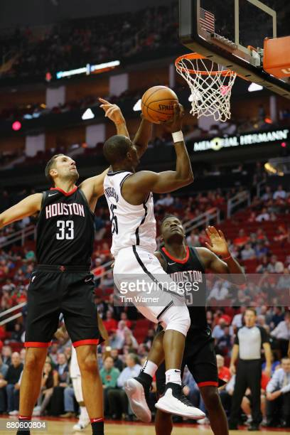 Isaiah Whitehead of the Brooklyn Nets goes up for a shot defended by Ryan Anderson of the Houston Rockets in the first half at Toyota Center on...