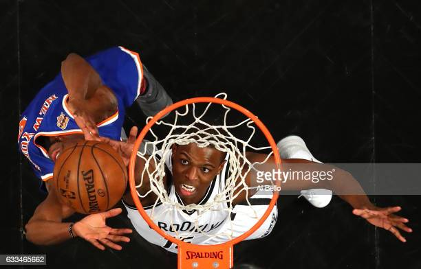 Isaiah Whitehead of the Brooklyn Nets rebounds against Justin Holiday of the New York Knicks during their game at the Barclays Center on February 1...