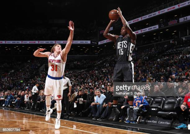 Isaiah Whitehead of the Brooklyn Nets shoots the ball against Ron Baker of the New York Knicks during the game on March 12 2017 at Barclays Center in...