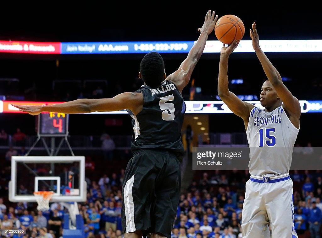 Isaiah Whitehead #15 of the Seton Hall Pirates attempts a three point shot as Rodney Bullock #5 of the Providence Friars defends during the second half of an NCAA college basketball game on February 25, 2016 at the Prudential Center in Newark, New Jersey. Seton Hall defeated Providence 70-52.
