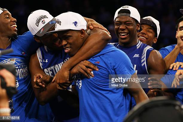 Isaiah Whitehead of the Seton Hall Pirates is mobbed by his teammates after winning the MVP during the Big East Basketball Tournament Championship at...