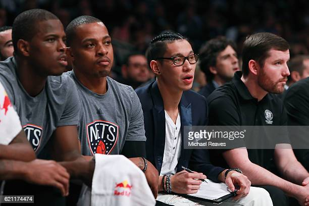 Isaiah Whitehead Randy Foye and Jeremy Lin of the Brooklyn Nets look on from the bench against the Charlotte Hornets during the second half at...