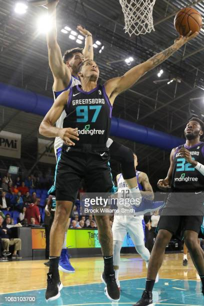 Isaiah Wilkins of the Greensboro Swarm goes to the basket against the Lakeland Magic during the NBA GLeague on November 17 2018 at the Greensboro...