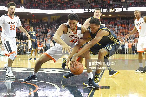 Isaiah Wilkins of the Virginia Cavaliers and Ivan Rabb of the California Golden Bears fight for loose ball during a college basketball game at John...