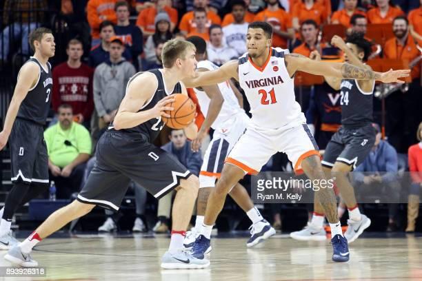 Isaiah Wilkins of the Virginia Cavaliers defends Peyton Aldridge of the Davidson Wildcats in the second half during a game at John Paul Jones Arena...