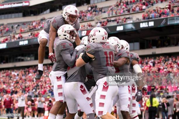 Isaiah Wright of the Temple Owls celebrates returning a punt for a touchdown with Branden Mack, Anthony Cruz, Ty Mason, and Zach Mesday in the second...