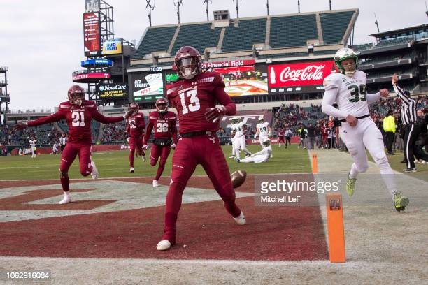 Isaiah Wright of the Temple Owls returns a punt for a touchdown in the fourth quarter past Trent Schneider of the South Florida Bulls at Lincoln...